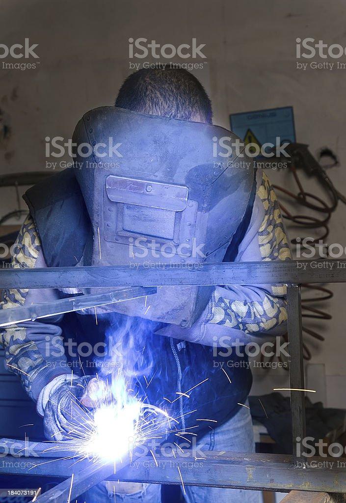 metalworker forging iron royalty-free stock photo