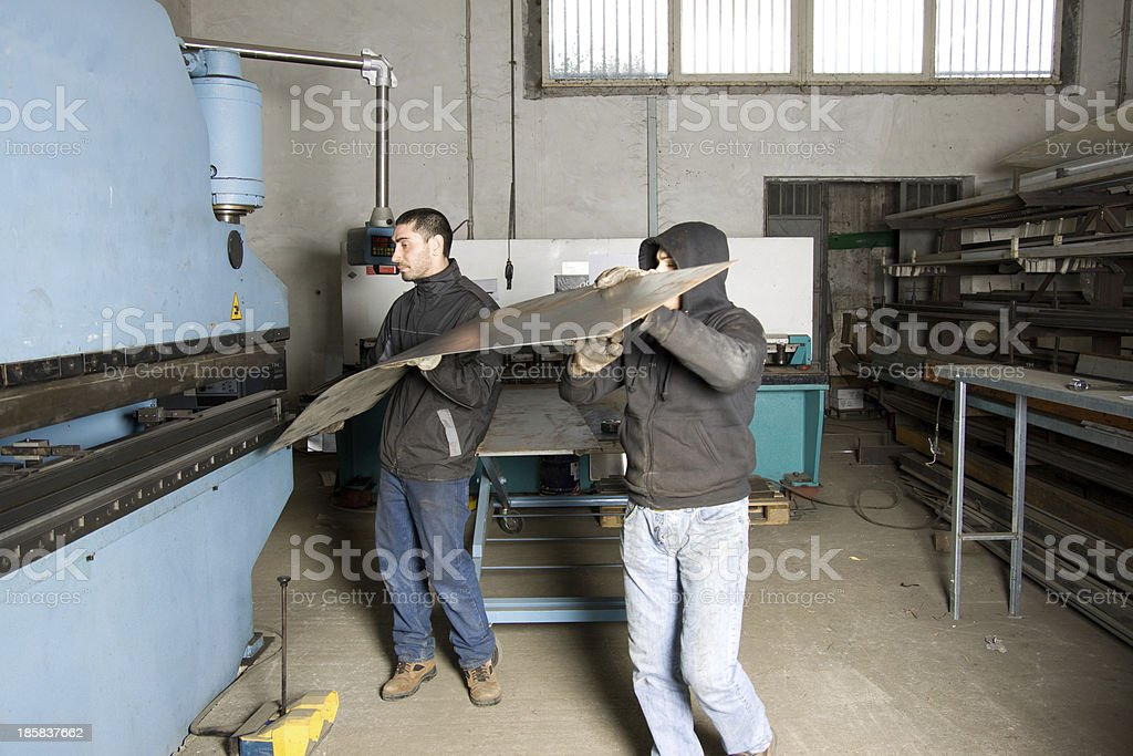 metalworker forging iron royalty-free stock photo