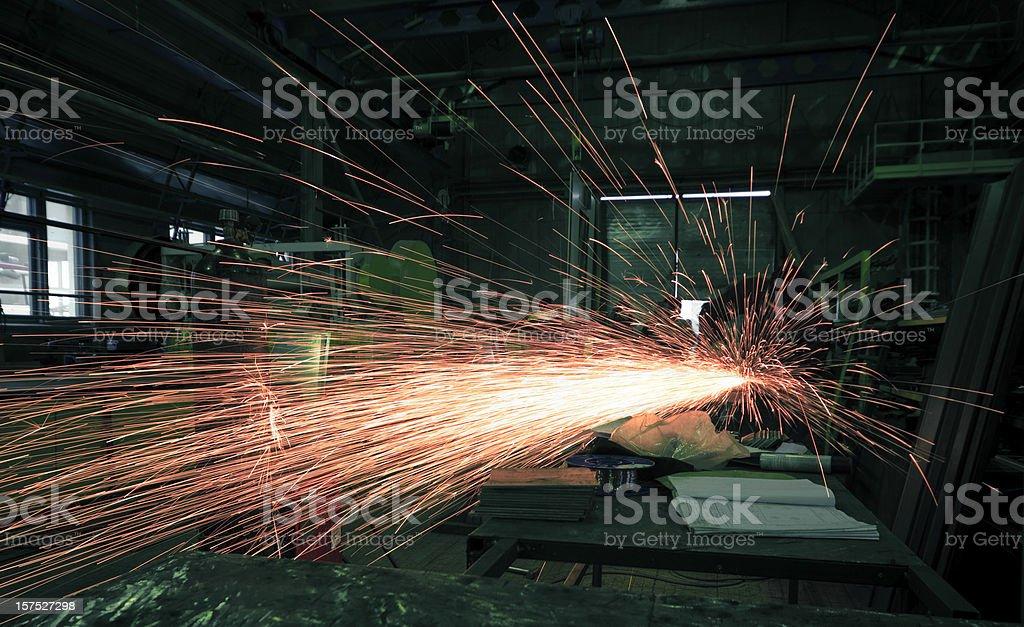 Metalworker on plant stock photo