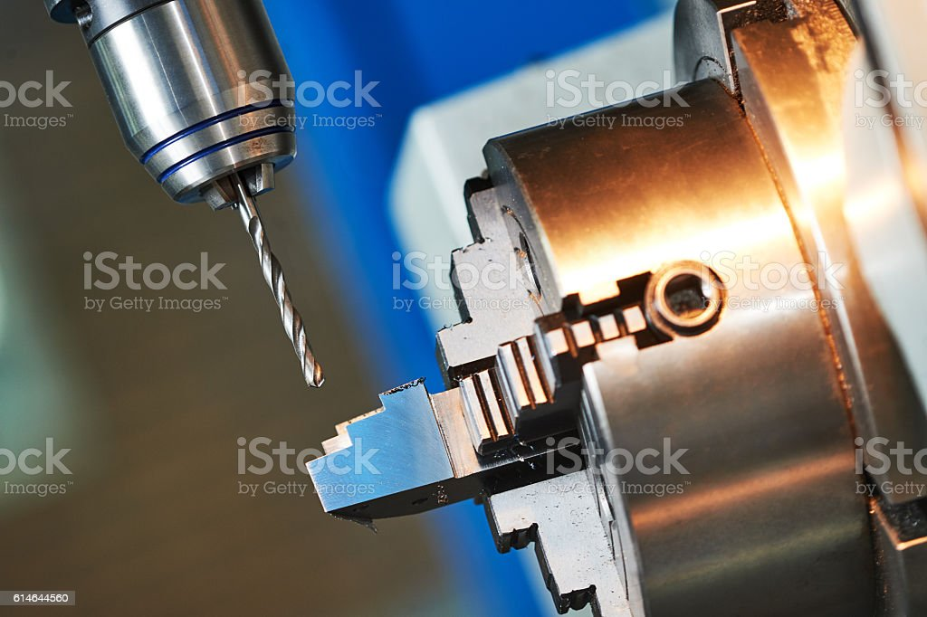 metalworking drilling process on cnc machine stock photo