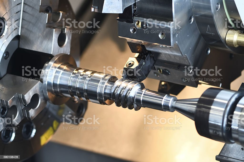 metalworking industry. cutting tool making worm shaft at metal working stock photo