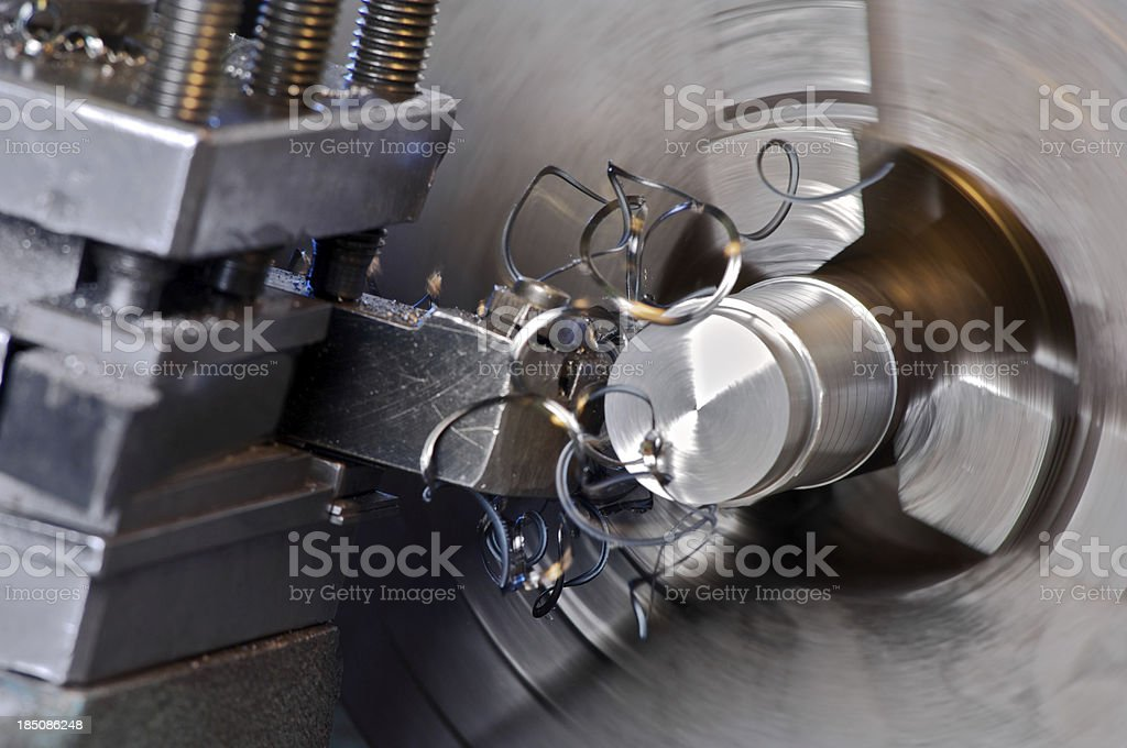 Metalworking lathe in operation stock photo