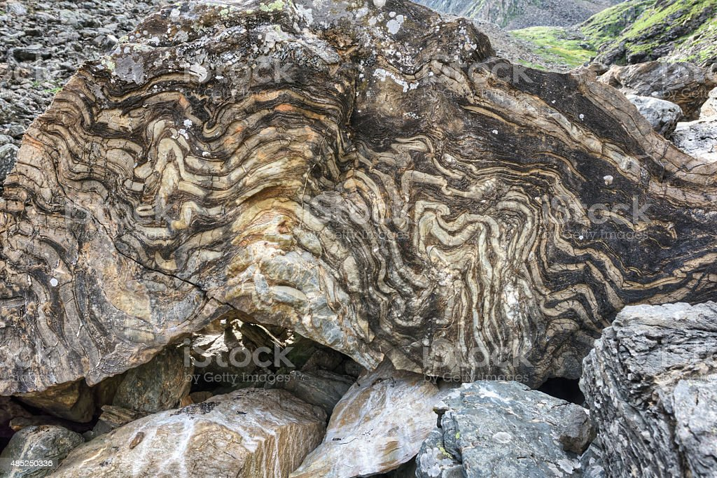 Metamorphic rock with a layered texture stock photo