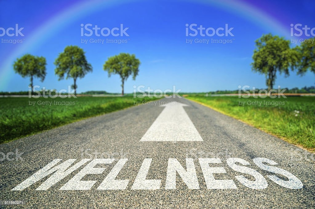 metaphor illustrating on the road the wellness and good health royalty-free stock photo