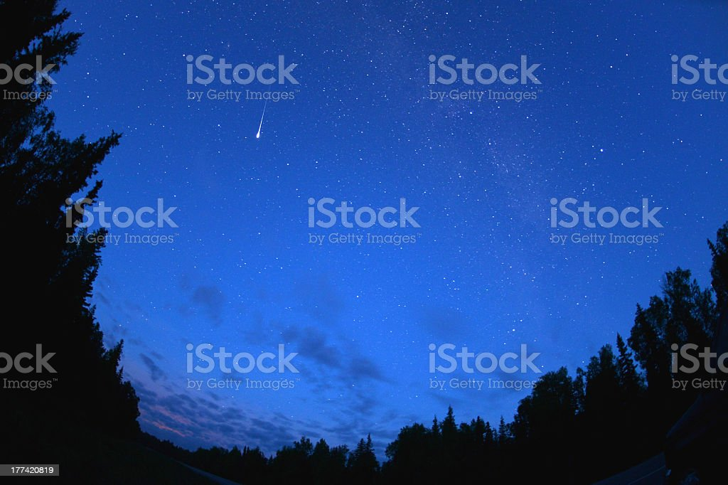 A meteor spotted in the night sky  stock photo