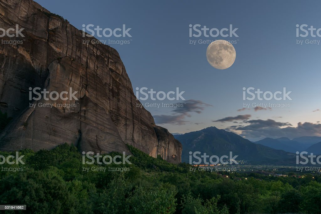 Meteora rock, Thessaly valley, night landscape with full moon stock photo
