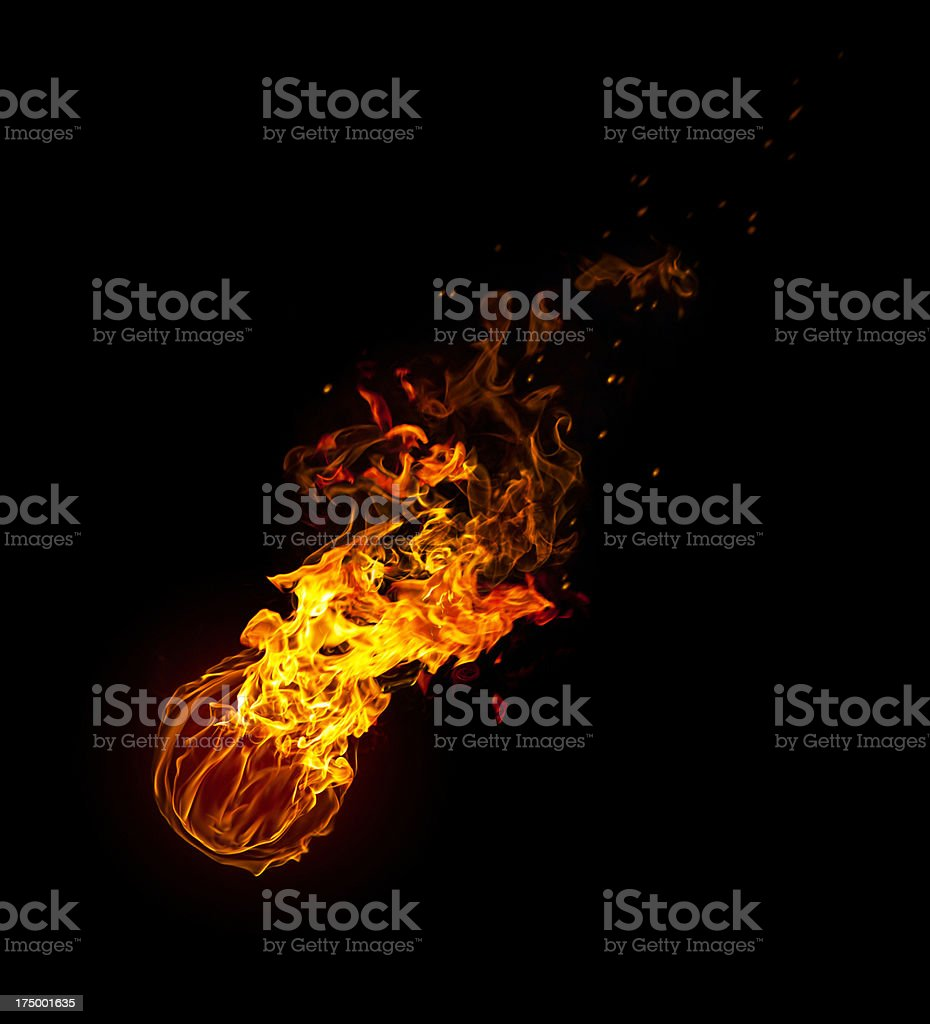 Meteorite fireball with tale of flames stock photo