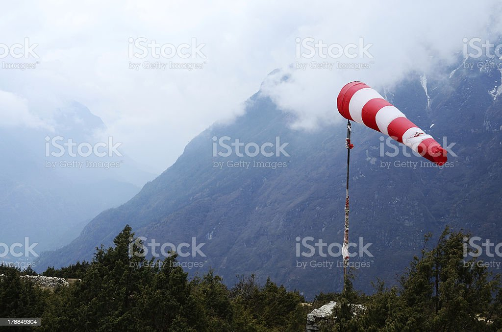 Meteorological red white windsock in Himalaya airport,Nepal stock photo
