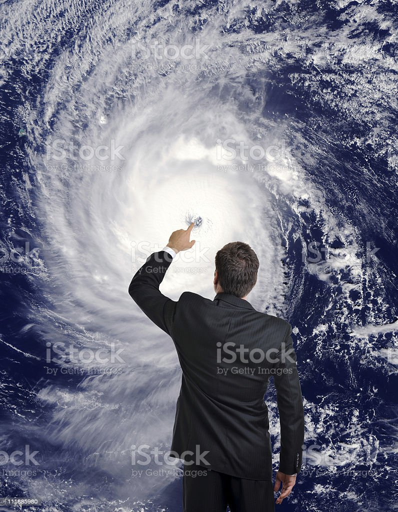 Meteorologist Man Touches Hurricane Eye Creating Climate Change royalty-free stock photo
