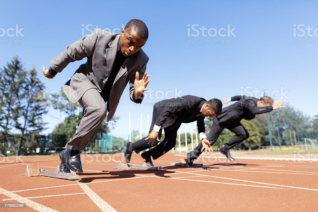 100 meter start in business suits stock photo
