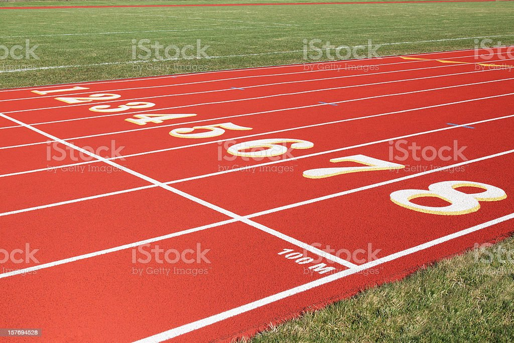 100 Meter Start Line on Red Eight Lanes Running Track stock photo