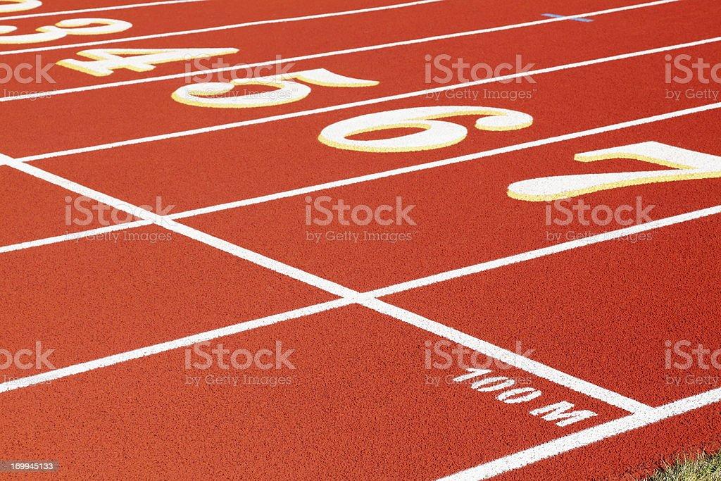 100 Meter Start Line on Red Running Track stock photo