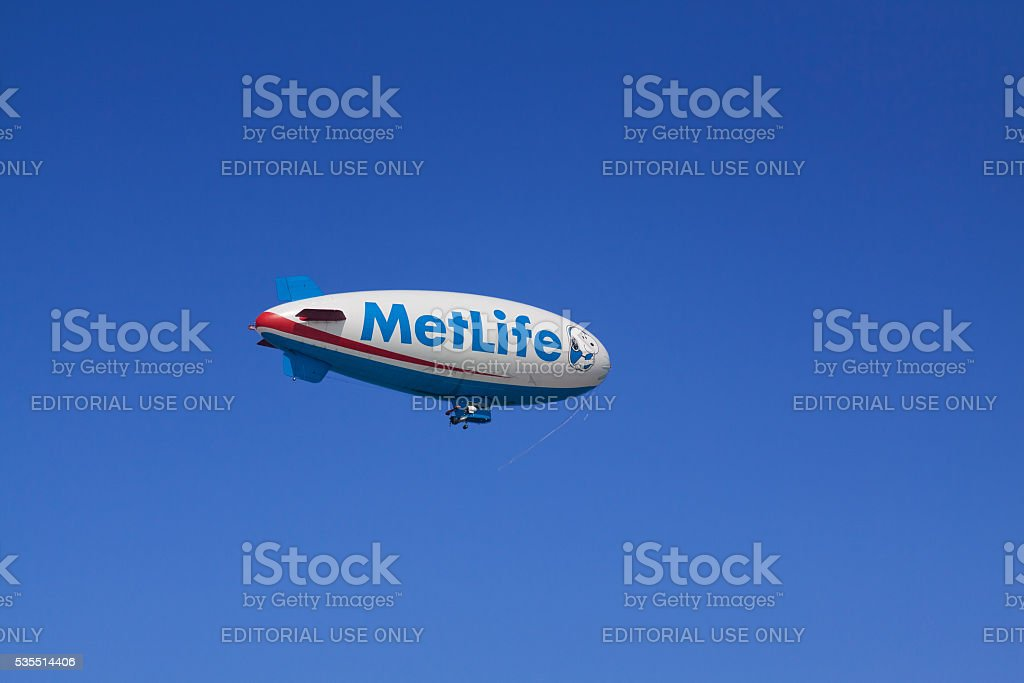 MetLife Blimp with Vivid Blue Clear Sky. stock photo