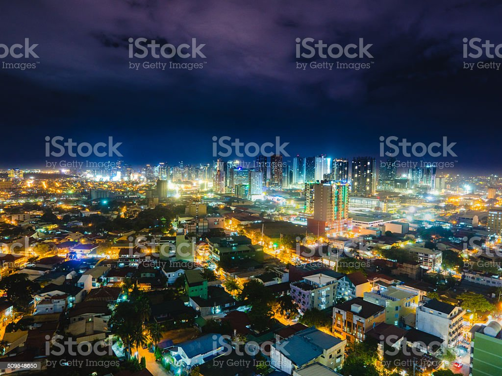 Metro Manila skyline at night stock photo
