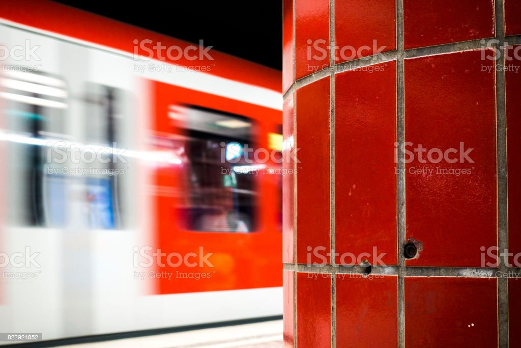 metro passing by red in red stock photo