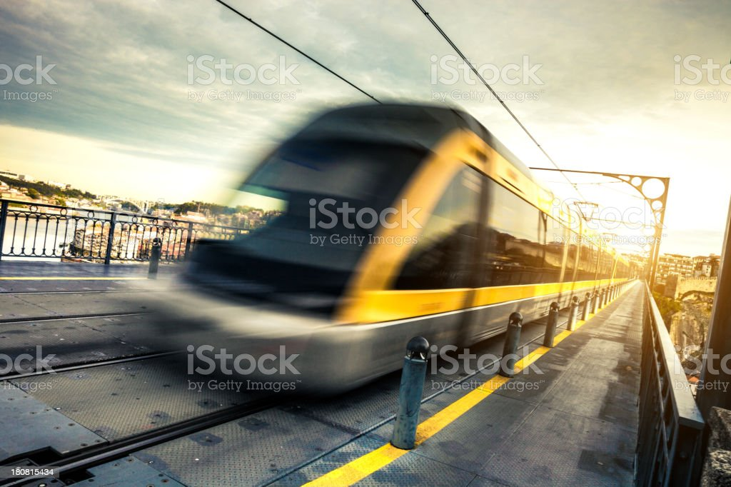 Metro train passes on a long suspended bridge stock photo