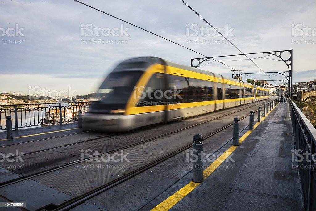 Metro train passes on a long suspended bridge royalty-free stock photo