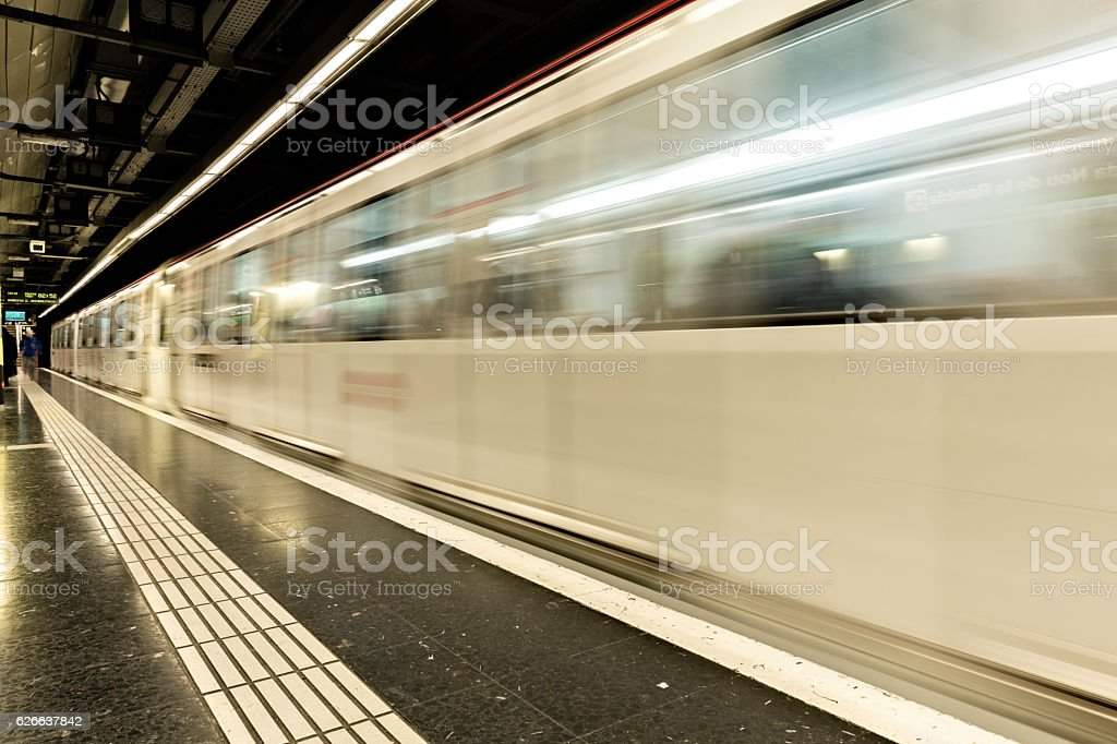 Metro train passing thought a station, motion blur stock photo