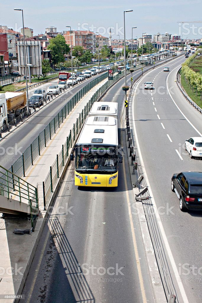 Metrobus on the move in Istanbul traffic stock photo