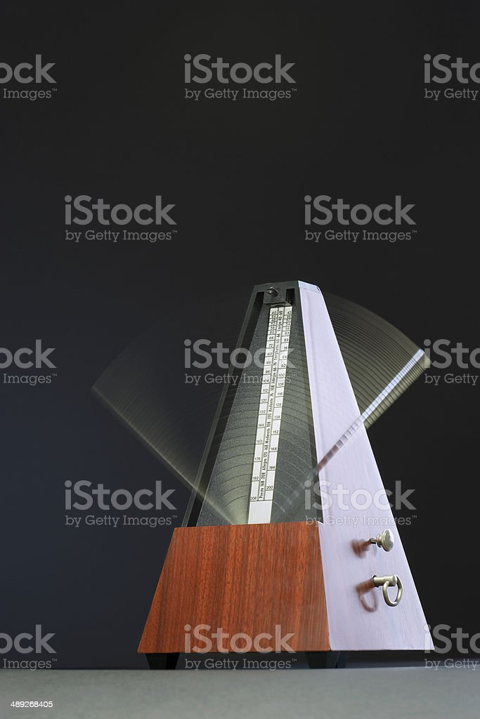 Metronome in motion stock photo