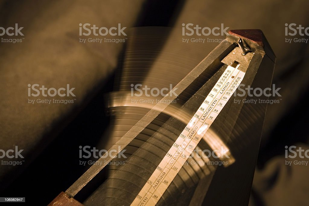 Metronome, Sepia Tone, Blurred Motion stock photo