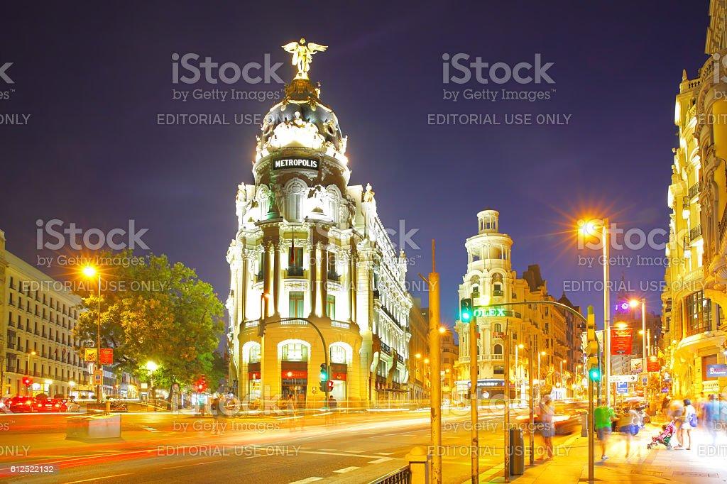 Metropolis building in Madrid at night stock photo