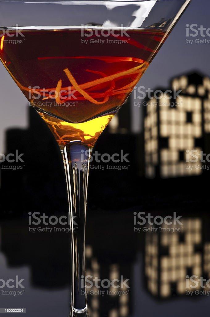 Metropolis Manhattan cocktail in city skyline setting stock photo