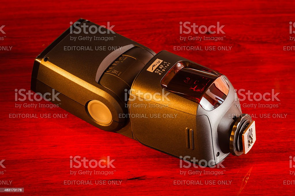 Metz 52 AF-1 Flash on rosewood table stock photo