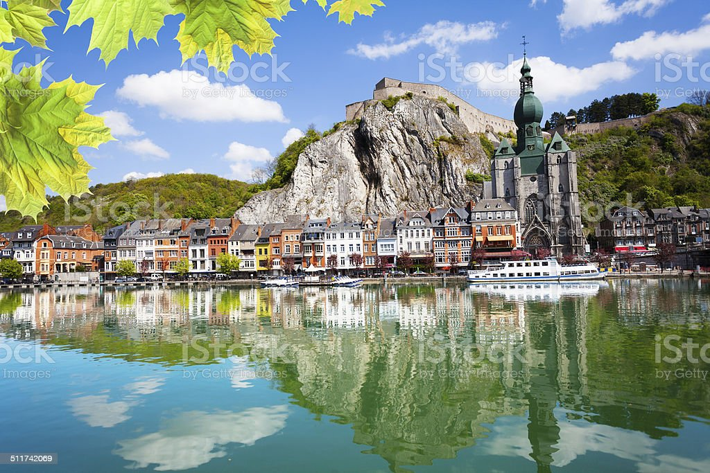 Meuse river with Collegiale Notre Dame, Belgium stock photo