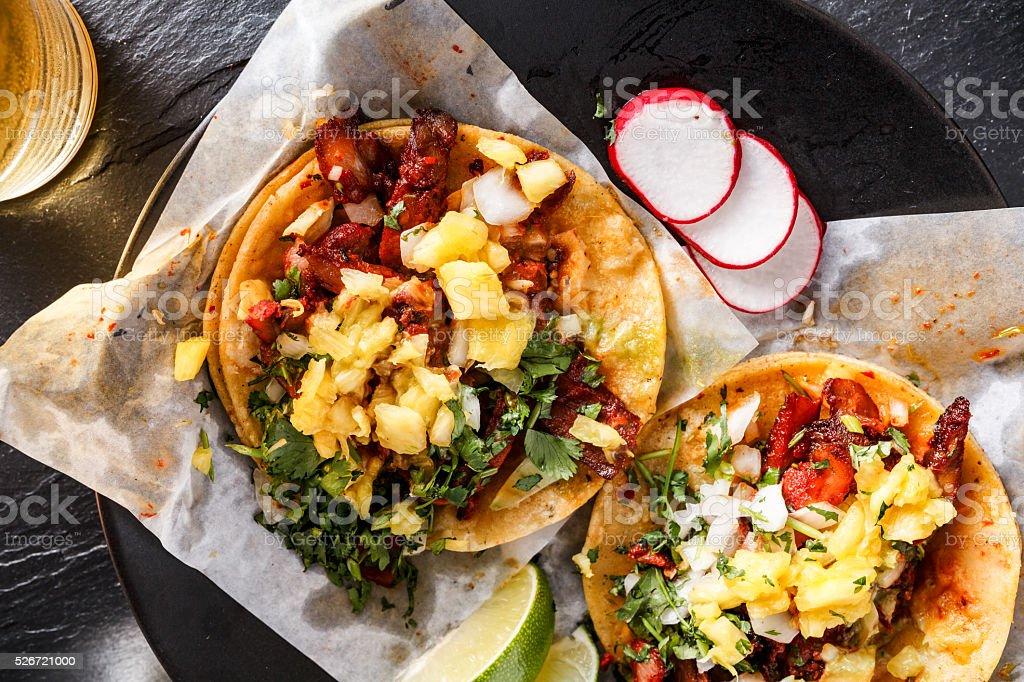mexican al pastor street tacos overhead shot close up stock photo