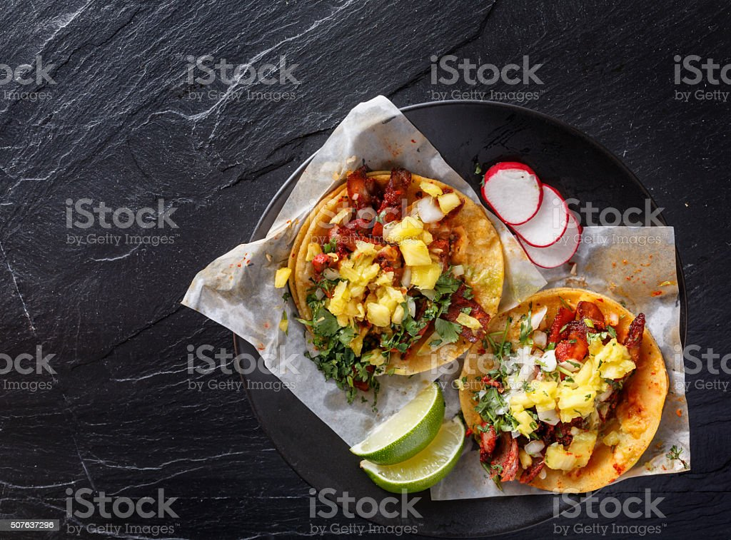 mexican al pastor street tacos shot from overhead stock photo