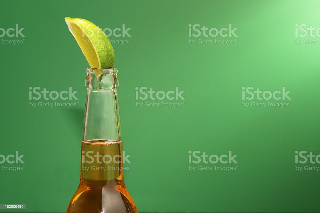 Mexican Beer with Lime on Green stock photo