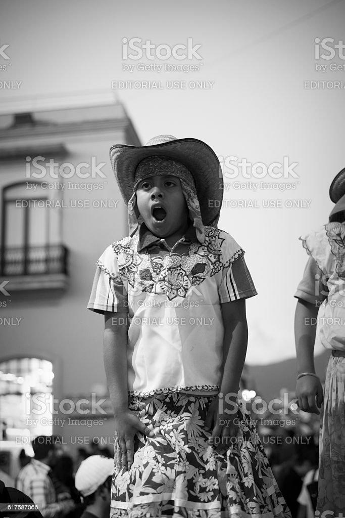 Mexican boy on stilts in Oaxaca, Mexico stock photo