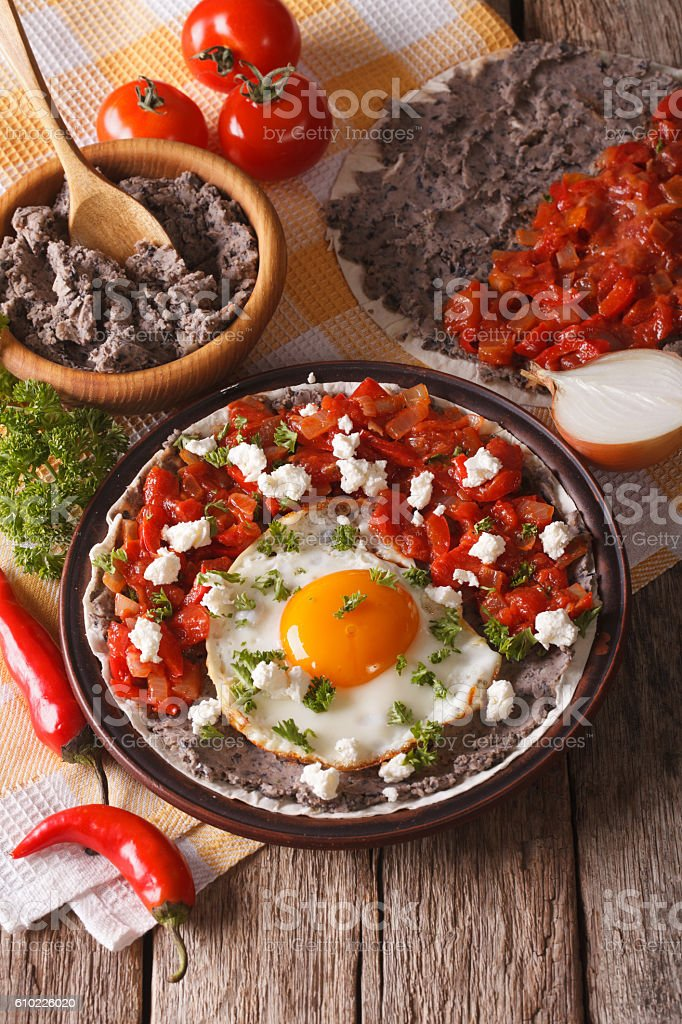 Mexican breakfast: fried egg with salsa on the plate close-up stock photo