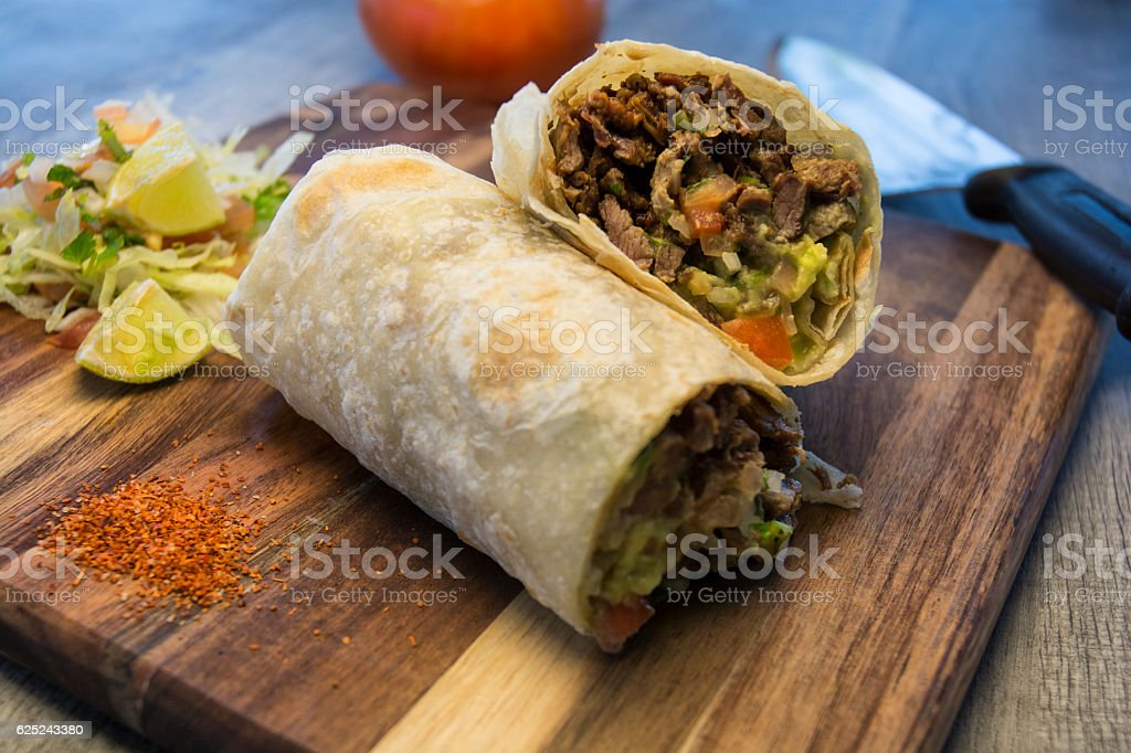 Mexican Burrito Meal With Lime And Red Pepper stock photo