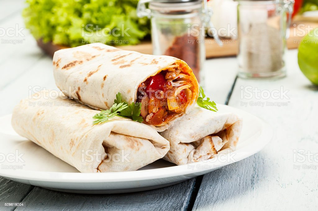 Mexican burritos on a plate stock photo