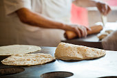 Mexican Chef Rolling, Frying Flour Tortillas in Restaurant Commercial Kitchen