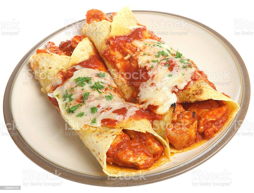 Mexican chicken enchiladas in a beige plate stock photo