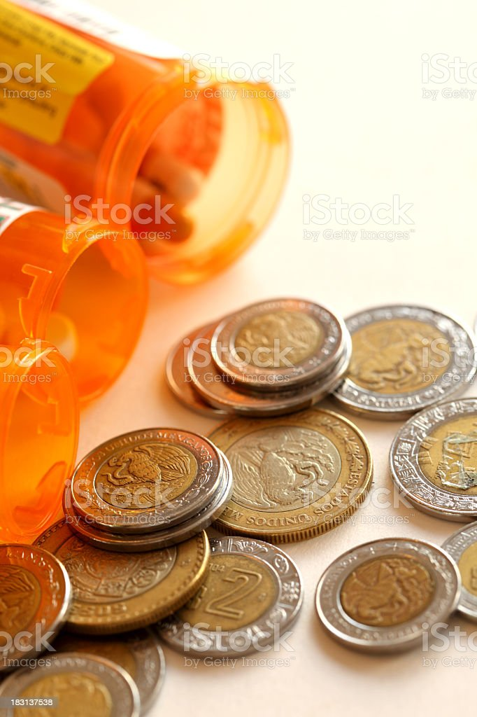 Mexican coins and pills stock photo