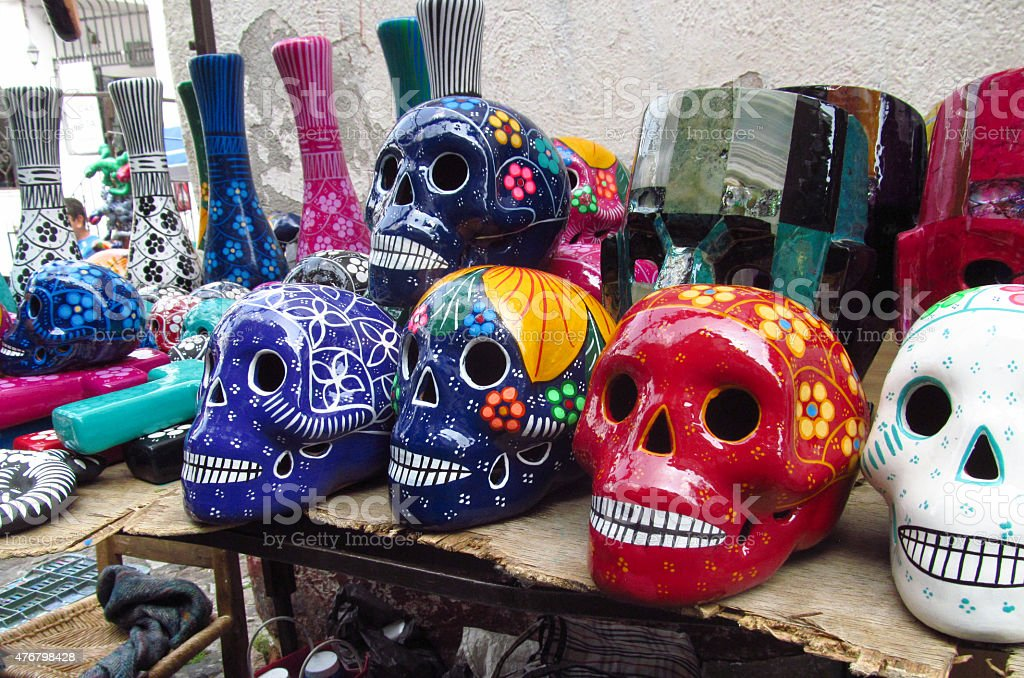 Mexican crafts colorful skulls tourism stock photo