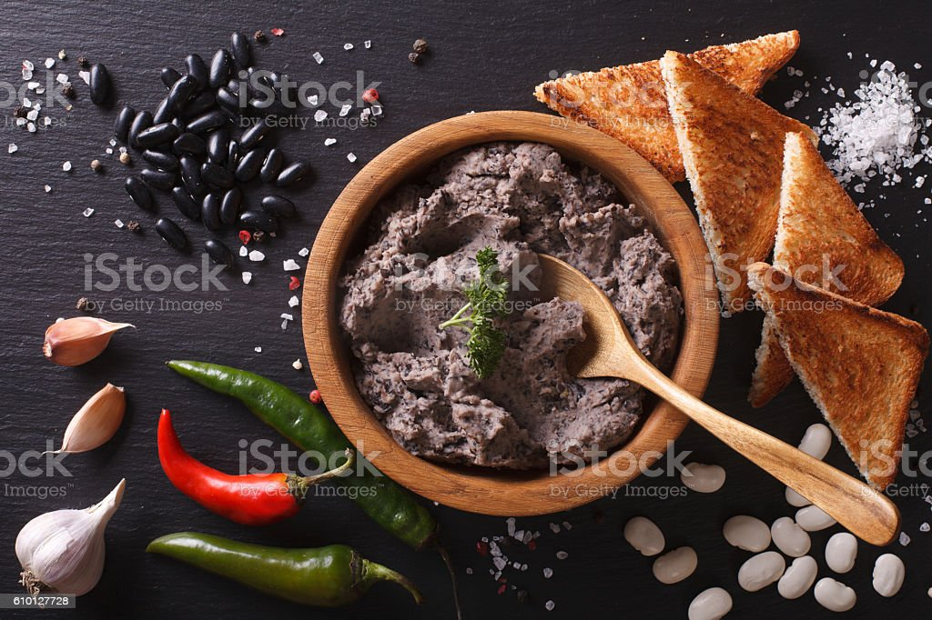 Mexican cuisine: pate of black beans close-up. horizontal stock photo