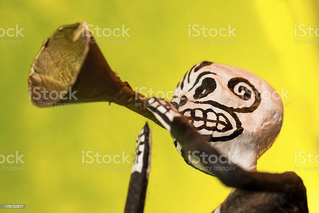 Mexican 'Day of the Dead' Figurine Blowing Trumpet stock photo