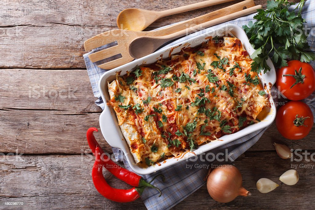Mexican enchilada in a baking dish horizontal top view stock photo
