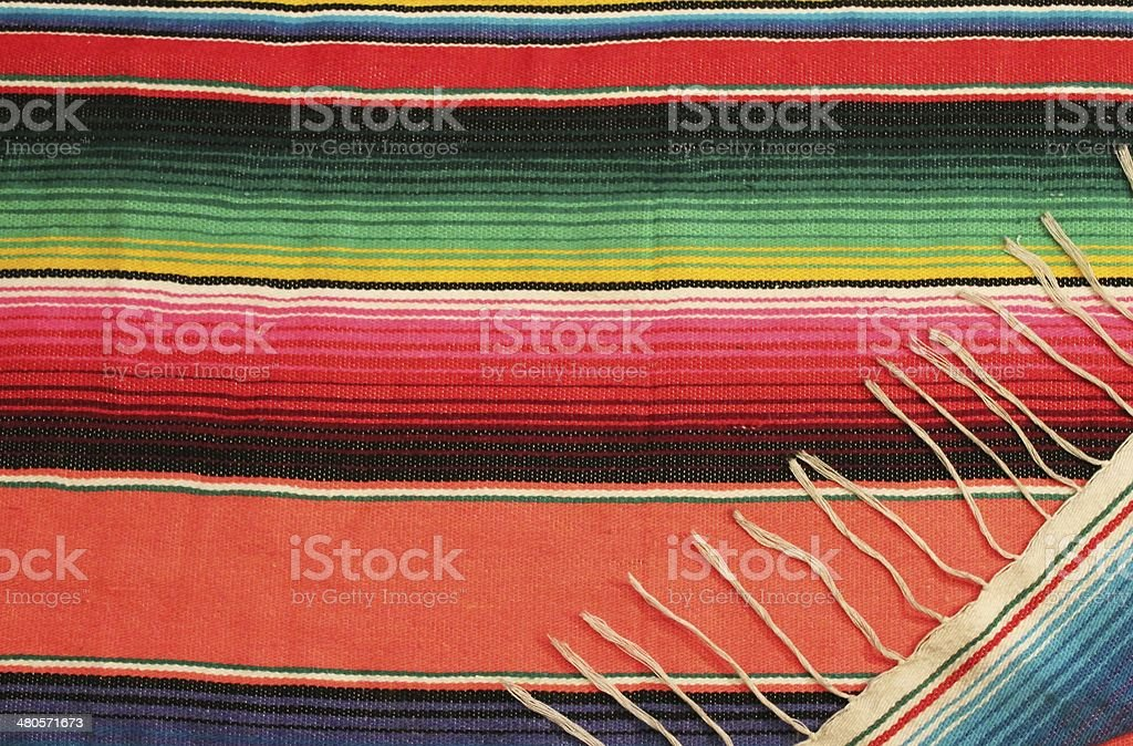 Mexican fiesta poncho rug background with copy space stock photo