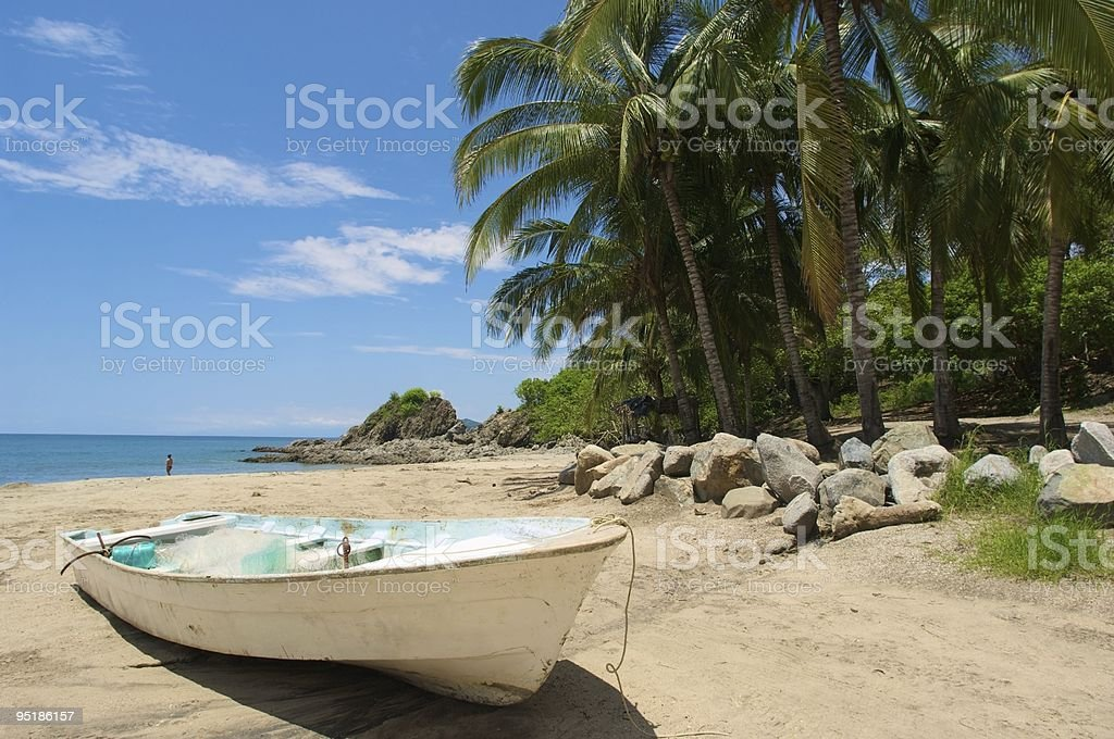 Mexican Fishing Boat on Beach stock photo