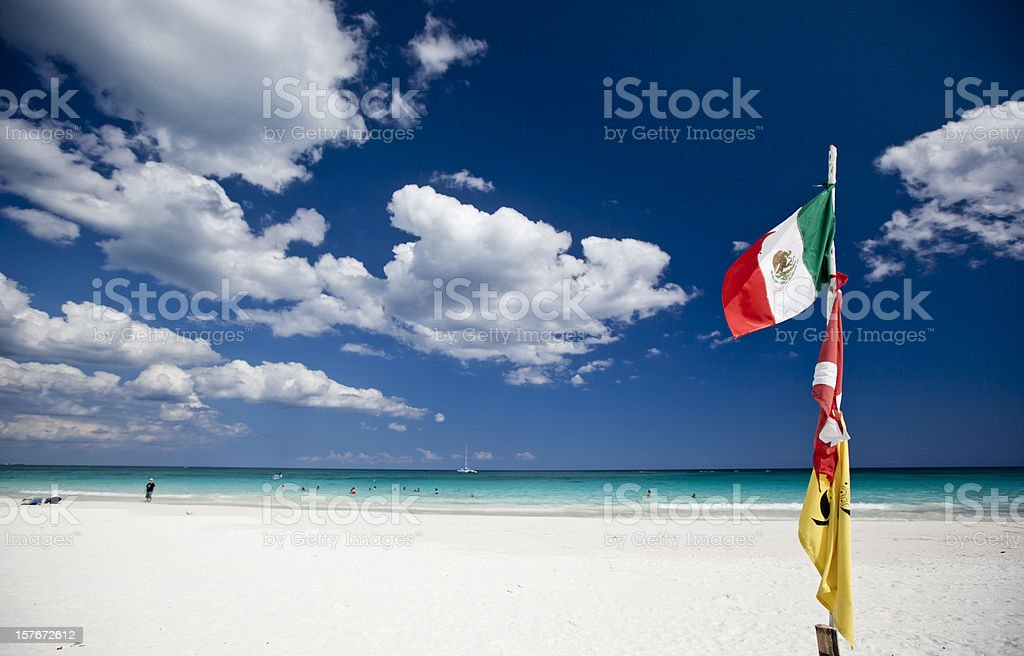 Mexican flag at the beach stock photo
