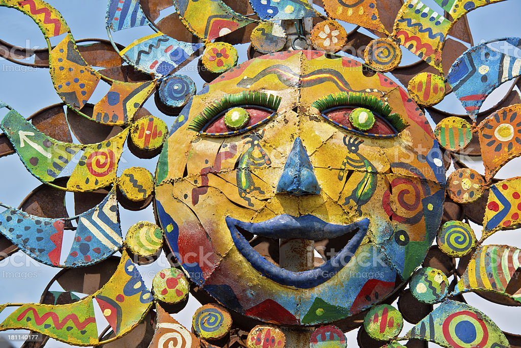 Mexican Folk Art Painted Metal Sun stock photo
