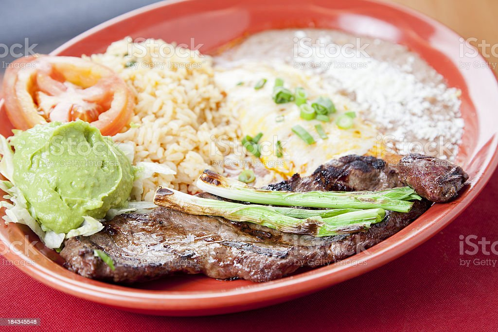 Mexican food: carne asada served with cheese enchilada stock photo