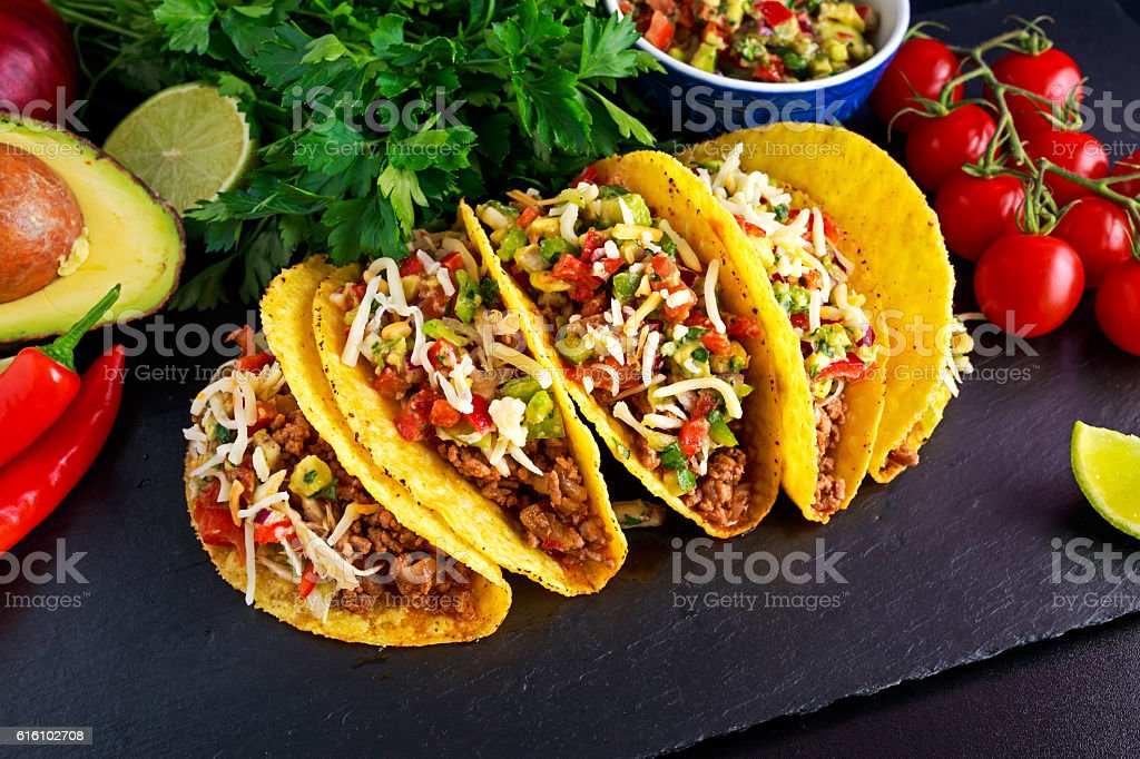 Mexican food - delicious taco shells with ground beef and stock photo