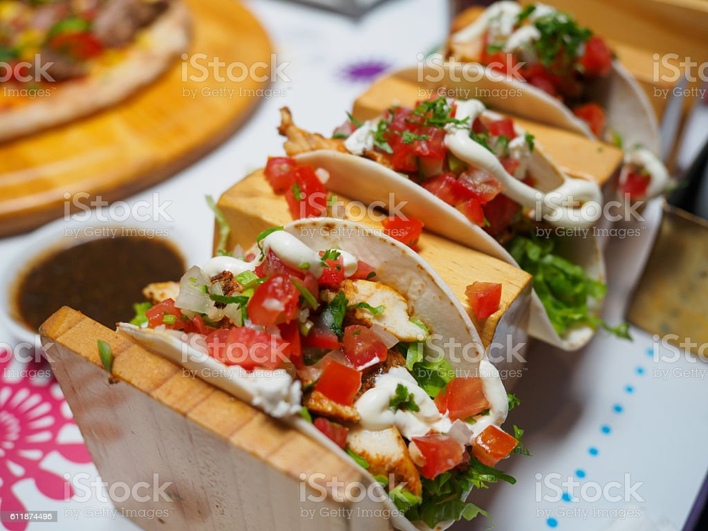 Mexican food - delicious tacos with chicken stock photo